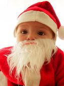 stock photo of santa claus hat  - Baby with a Santa Claus disguise - JPG