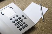 pic of dial pad  - Telephone for customer service and blank white note paper with pen in hotel room - JPG