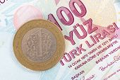stock photo of turkish lira  - One Turkish lira coin on one hundred banknote - JPG
