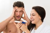 pic of pregnancy test  - Portrait Of Young Couple Looking At Pregnancy Test Over White Background - JPG