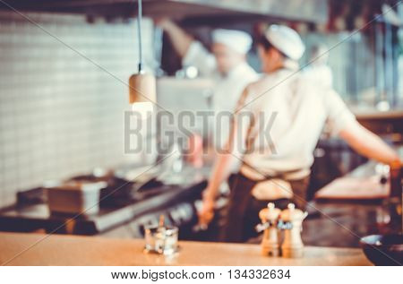 Blurred background : Group of chefs cooking in the kitchen