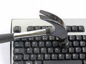 Hammer And Computer Keyboard
