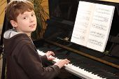 Teenage Boy Plays Piano