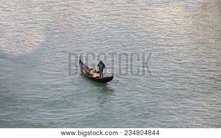 Lonely Gondolier With Black Gondola