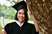 Graduation Concept. Graduated Students On Graduation Day. Asian Students Are Smiling Happily On The  poster