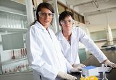 Science students wearing protective glasses in a laboratory