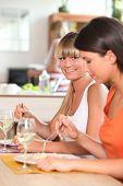 Women eating dinner together