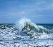 Huge breaking stormy wave. Big wave. poster
