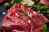 Flat Lay Of Raw Beefsteak With Tomatoes, Garlic, Hot Pepper, Dill, Parsley, Rosemary And Spicies On  poster