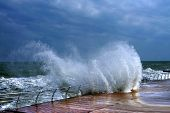 Huge breaking stormy wave. Big wave. The big wave is breaking about the shore poster