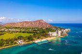 Honolulu, Hawaii. Aerial Skyline View Of Honolulu, Diamond Head Volcano Including The Hotels And Bui poster