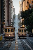 Classic View Of Historic Traditional Cable Cars Riding On Famous California Street In Morning Light  poster