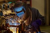 Worker Is Welding Automotive Part In Car Factory poster