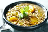 closeup of lentil soup, the lentils have cooked for 3 hours in order to form its own thick sauce, it