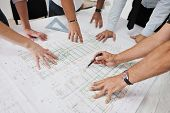 foto of real-estate-team  - Team of architects people in group  on construciton site check documents and business workflow - JPG