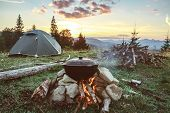 Tourist Camp With Fire, Tent And Firewood poster
