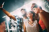Happy Young Friends Taking Selfie At Music Festival poster