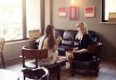 Psychologist Consulting A Woman Client Indoors Discussion Therapy, Blurred Defocused View Two Women  poster