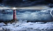 Lighthouse In Stormy Landscape - Leader And Vision Concept poster