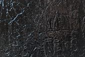 The Metal Surface Is Painted With Black Oil Paint. Under Paint The Bottom Layer Of Cracked Old Paint poster