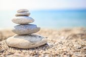 Stones Are Lined With Pyramid On Beach. Pebbles. Stones Pyramid Symbolizing Zen, Harmony, Balance On poster