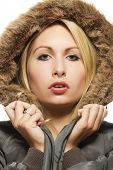 beautiful blonde woman wearing a parka with fur