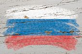 Flag Of Russia On Grunge Wooden Texture Painted With Chalk