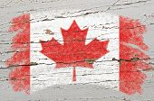 Flag Of Canada On Grunge Wooden Texture Painted With Chalk