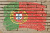 Flag Of Portugal On Grunge Brick Wall Painted With Chalk