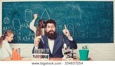 poster of Man Bearded Teacher Work With Microscope And Test Tubes In Biology Classroom. School Teacher Of Biol