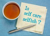 Is self care selfish?  Handwriting on a napkin with coffee. Body care and wellness concept. poster