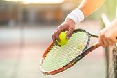 Close Up Of Tennis Player Hands Holding Racket With Ball. poster