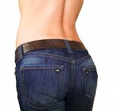 Attractive Girl Buttocks In Jeans With Tanned Back Isolated On White Background