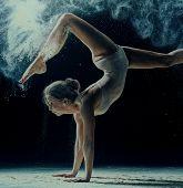 Graceful Woman Dancing In Cloud Of Dust poster