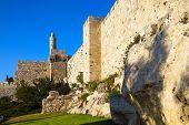 Hot summer sunset. Adorable green lawn growing under ancient walls. Old Jerusalem. Ancient Citadel - poster