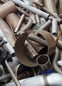 stock photo of ferrous metal  - assortment of scrap metal ready for recycling - JPG