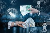The Concept Of The Exchange Of The Dollar And The Euro. Hand With Euro And Dollars On The Background poster