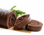 Chocolate  Yule Log Christmas Cake Coated With Milk Chocolate Isolated On White poster