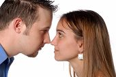 Man And Woman Nose To Nose Discussing Business