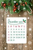 Christmas Calendar Wood Plank In Vertical With Pine Leaves And Cones, Holly Balls, Snow And Candy Ca poster
