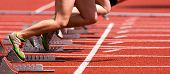 image of track field  - athlete in a sprint start in track and field - JPG