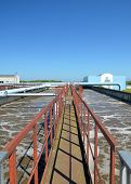 stock photo of wastewater  - Modern urban wastewater treatment plant with blue sky - JPG