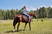 Teenager Girl Riding A Brown Horse, Horseback Riding For People In The Park. poster
