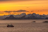 Fishing Boat With Dramatic Sunset In Background In Lofoten, Norway. Amazing Landscape. poster
