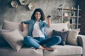 Photo Of Pretty Dark Skin Wavy Lady Homey Mood Holding Tv Remote Control Changing Channel Searching  poster