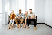 Group Of A Young Friends Having Fun While Playing Video Games On The Couch At Home. Concept Of Leisu poster