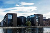 Business Center In Copenhagen, Denmark. Row Of Modern Buildings Near The River. poster