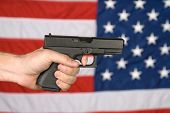 American Flag And Hand Held Pistol