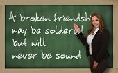 Teacher Showing  A Broken Friendship May Be Soldered But Will On Blackboard