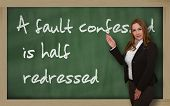 Teacher Showing A Fault Confessed Is Half Redressed On Blackboard